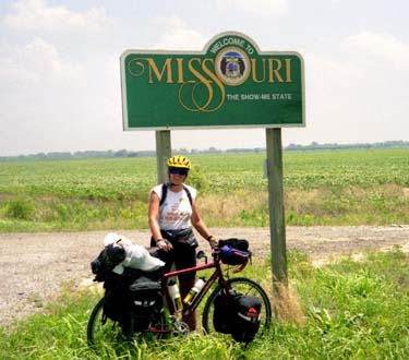 Kathy at the Missouri state sign